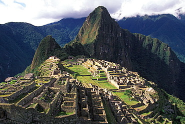 Machu Picchu view of the ancient city with Huayna Picchu Peak above the Rio Urubamba in the Vilcabamba Mountains, Highlands, Peru - 763-852