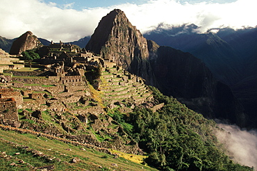 Machu Picchu view of the ancient city with Huayna Picchu Peak above the Rio Urubamba in the Vilcabamba Mountains north of Cuzco, Highlands, Peru