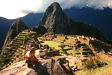 Machu Picchu view of the ancient city with Huayna Picchu Peak above the Rio Urubamba hikers viewing site from end of Inca Trail, Highlands, Peru