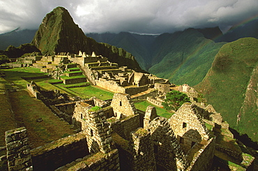 Machu Picchu view of the ancient city with Huayna Picchu Peak above the Rio Urubamba in the Vilcabamba Mountains, Highlands, Peru