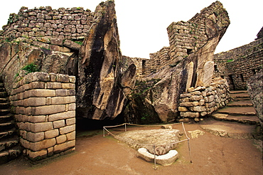 Machu Picchu the Prison Group with a carved stone forming the head of a condor and natural stones forming the wings, Highlands, Peru