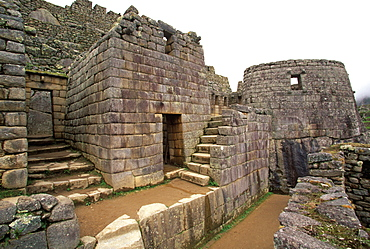 Inca Machu Picchu skillfully carved, curved wall of the Sun Temple, is considered to be the finest stone construction in the site, Highlands, Peru