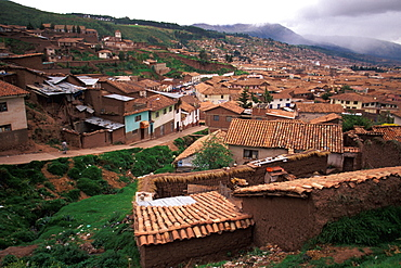 One of the world's most famous train rides thru the Inca Sacred Valley between Cuzco and Machu Picchu passing Cuzco rooftops, Peru