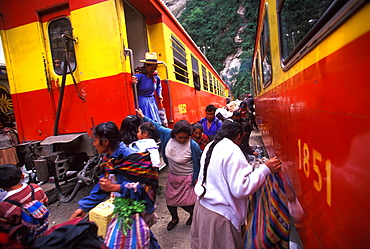 Machu Picchu the train from Cuzco arrives in Aguas Calientes the town and railroad station below site passengers unloading supplies, Highlands, Peru