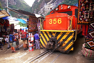 Machu Picchu the train from Cuzco arrives in Aguas Calientes the town and station below site train passes vendors on main street, Highlands, Peru