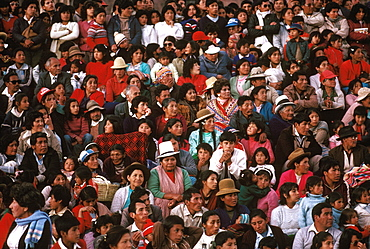 Corpus Christi Festival in Cuzco spectators sitting on the steps below the Cathedral watching the procession in the Plaza de Armas, Peru