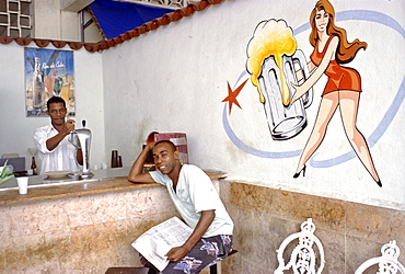 A soda shop in Centro Habana with a bit of classic artwork on the wall, Havana, Cuba