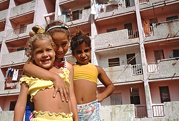 Children playing in front of an apartment house in the Habana Libre area of Havana, Cuba