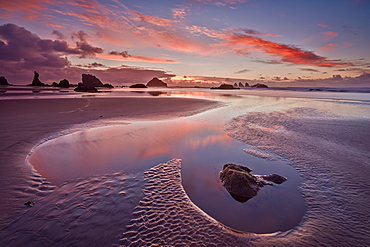 Sunset with orange clouds, Bandon Beach, Oregon, United States of America, North America