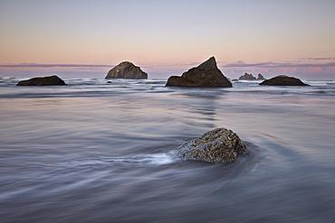 Rock, sea stacks and waves at dawn, Bandon Beach, Oregon, United States of America, North America