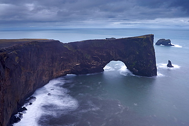 Dyrholaey natural arch, southernmost point in Iceland, at dusk, near Vik, Iceland, Polar Regions