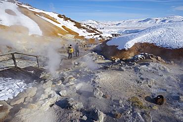 Tourists watching geothermal activity of mudpots, hot springs and fumaroles, at Krisuvik (Krysuvik-Seltun), Reykjanes Peninsula, south-west Iceland, Iceland, Polar Regions