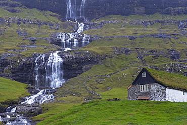 Old farm at Saksun and waterfall, Streymoy, Faroe Islands (Faroes), Denmark, Europe