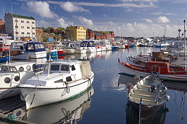 Colourful boats and picturesque gabled buildings along the quayside in Vestaravag harbour, Torshavn, Streymoy, Faroe Islands (Faroes), Denmark, Europe