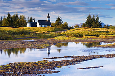 Thingvellir national church, built in 1859 on the site of Iceland's first church constructed in 1000 AD, seen from Oxaraholmi, an island in the River Oxara, site of legal duelling in the past, Thingvellir National Park, UNESCO World Heritage Site, south-west Iceland (Sudurland), Iceland, Polar Regions