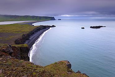 Reynisfjara black sand beach and Reynisdrangar sea stacks in the distance, from Dyrholaey near Vik, Iceland, Polar Regions