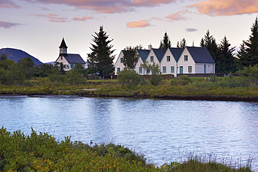 Thingvellir national church and Thingvallabaer, a five-gabled farmhouse, official summer residence of Iceland's Prime Minister, on the banks of River Oxara, Thingvellir National Park, UNESCO World Heritage Site, south-west Iceland (Sudurland), Iceland, Polar Regions