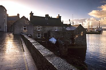 Lerwick seafront, with wharves and slipways, and stone warehouses (lodberries), Lerwick, Mainland, Shetland Islands, Scotland, United Kingdom, Europe