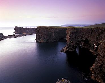 Eshaness basalt cliffs, deeply eroded with caves, blowholes and stacks, Northmavine, Shetland Islands, Scotland, United Kingdom, Europe