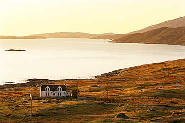 Sunset over Loch Tarbert and house, Isle of Harris, Outer Hebrides, Scotland, United Kingdom, Europe