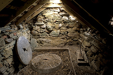 Interior of a restored old click mill alongside a small burn, used to grind grain in earlier times, Huxter, West Mainland, Shetland Islands, Scotland, United Kingdom, Europe