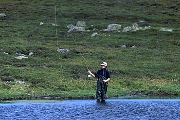 Fly fishing for trout in a loch, Shetland Islands, Scotland, United Kingdom, Europe