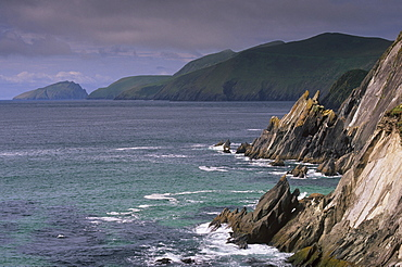 Rocky coast of Slea Head, and Blasket islands in the distance, Dingle peninsula, County Kerry, Munster, Republic of Ireland, Europe