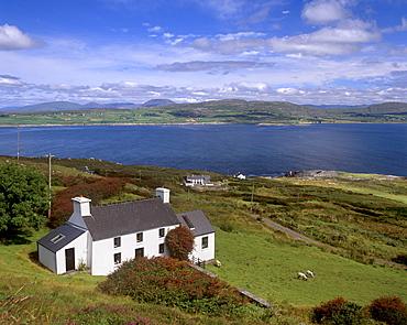 House, north coast of Mizen peninsula, Dunmanus Bay and hills of Sheep's Head behind, near Dunmanus, County Cork, Munster, Republic of Ireland, Europe