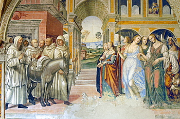 Frescoes in cloister by High Renaissance painter Il Sodoma (Giovanni Antonio Bazzi) painted between 1505 and 1508, of the life of St. Benedict (San Benedetto) showing him driving off bad women brought in by Florent. Chiusure, Monte Oliveto Maggiore Abbey, Tuscany, Italy, Europe