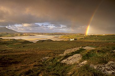 Rainbow over Uig sands (Traigh Chapadail), tidal area, from near Timsgarry, Isle of Lewis, Outer Hebrides, Scotland, United Kingdom, Europe