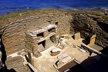One of eight stone houses with stone furniture including beds, a central hearth and stone dresser, Skara Brae, neolithic village dating from between 3200 and 2200 BC, UNESCO World Heritage Site, Mainland, Orkney Islands, Scotland, United Kingdom, Europe