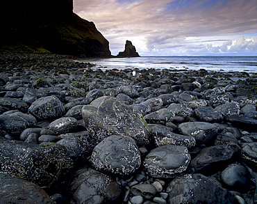 Black boulder rocks in Talisker Bay, Isle of Skye, Inner Hebrides, Scotland, United Kingdom, Europe