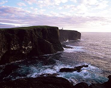 Sunset over Eshaness basalt cliffs, Eshaness, Northmavine, Shetland Islands, Scotland, United Kingdom, Europe