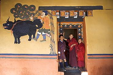 Bhutanese boy and monks, Paro Dzong, Paro, Bhutan, Asia