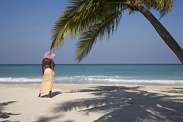 Jamaican woman on beach, Negril, Jamaica, West Indies, Caribbean, Central America