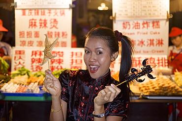 Asian woman (Chinese-Thai), Dong'anmen food market, Wanfungjing, Beijing, China, Asia