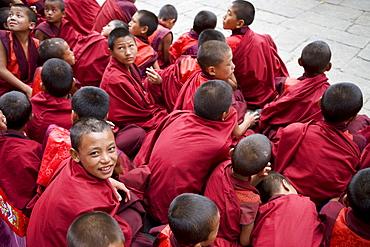 Monks watching religious dances, Buddhist festival (Tsechu), Trashi Chhoe Dzong, Thimphu, Bhutan, Asia