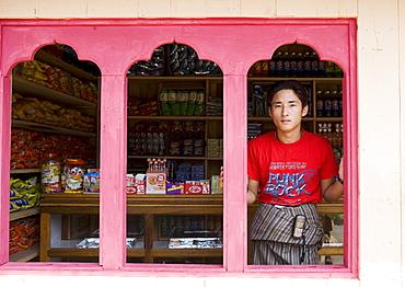 Young shop owner, village of Wangdue Phodrang, Bhutan, Asia