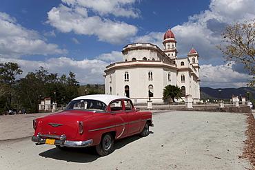 Old Chevrolet at the Church of Caridad del Cobre, Santiago de Cuba, Santiago de Cuba Province, Cuba, West Indies, Central America