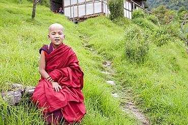 Young Buddhist monk, Karchu Dratsang Monastery, Bumthang, Bhutan, Asia