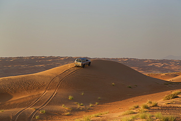 Four wheel drive on desert dunes, Wahiba, Oman, Middle East