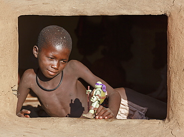 Himba boy with toy, Kaokoland, Namibia, Africa