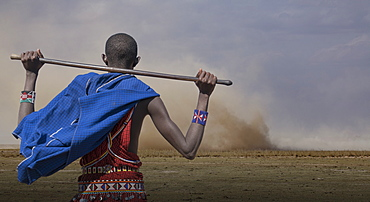 Masai man watching wind storm in Amboseli National Park, Kenya, East Africa, Africa
