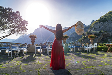 Woman with red dress on the Amalfi Coast, Campania, Italy, Europe