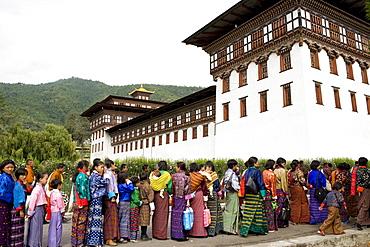 Women entering temple for Buddhist festival (Tsechu), Trashi Chhoe Dzong, Thimphu, Bhutan, Asia