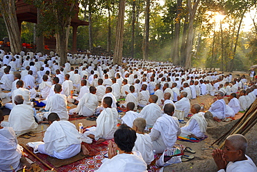 Buddhist monks and nuns gather for a ceremony for peace, Bayon temple, Angkor, Cambodia, Indochina, Southeast Asia, Asia
