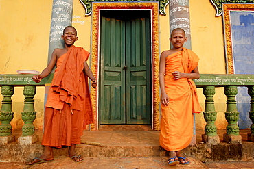 Young Buddhist novices relax outside their temple in Sen Monorom, Mondulkiri province, Cambodia, Indochina, Southeast Asia, Asia