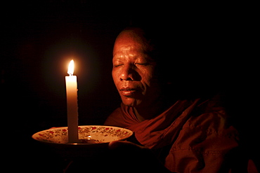 A monk meditates at a Buddhist temple in Sen Monorom, Mondulkiri province, Cambodia, Indochina, Southeast Asia, Asia