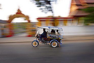 Tuk Tuk racing through Vientiane, Laos, Indochina, Southeast Asia, Asia