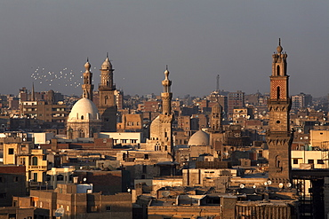 Minarets tower over Islamic Cairo and the area of Khan al-Khalili, Cairo, Egypt, North Africa, Africa
